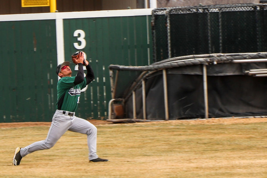 Ben Tsui, outfielder from Sydney, Australia, runs down a fly ball in right field. The sophomore has had 30 put outs so far this year, giving him a fielding percentage of .938.