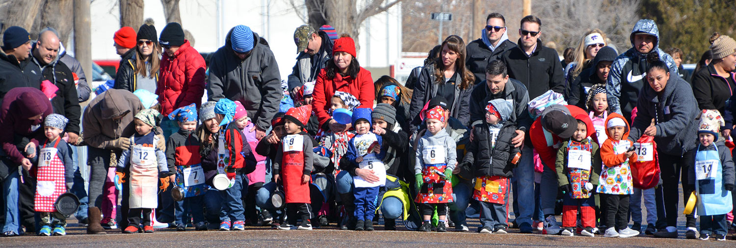 The+freezing+weather+didn%27t+stop+the+community+from+gathering+and+celebrating+the+event.+Parents+are+helped+prep+their+kids+for+the+race.+