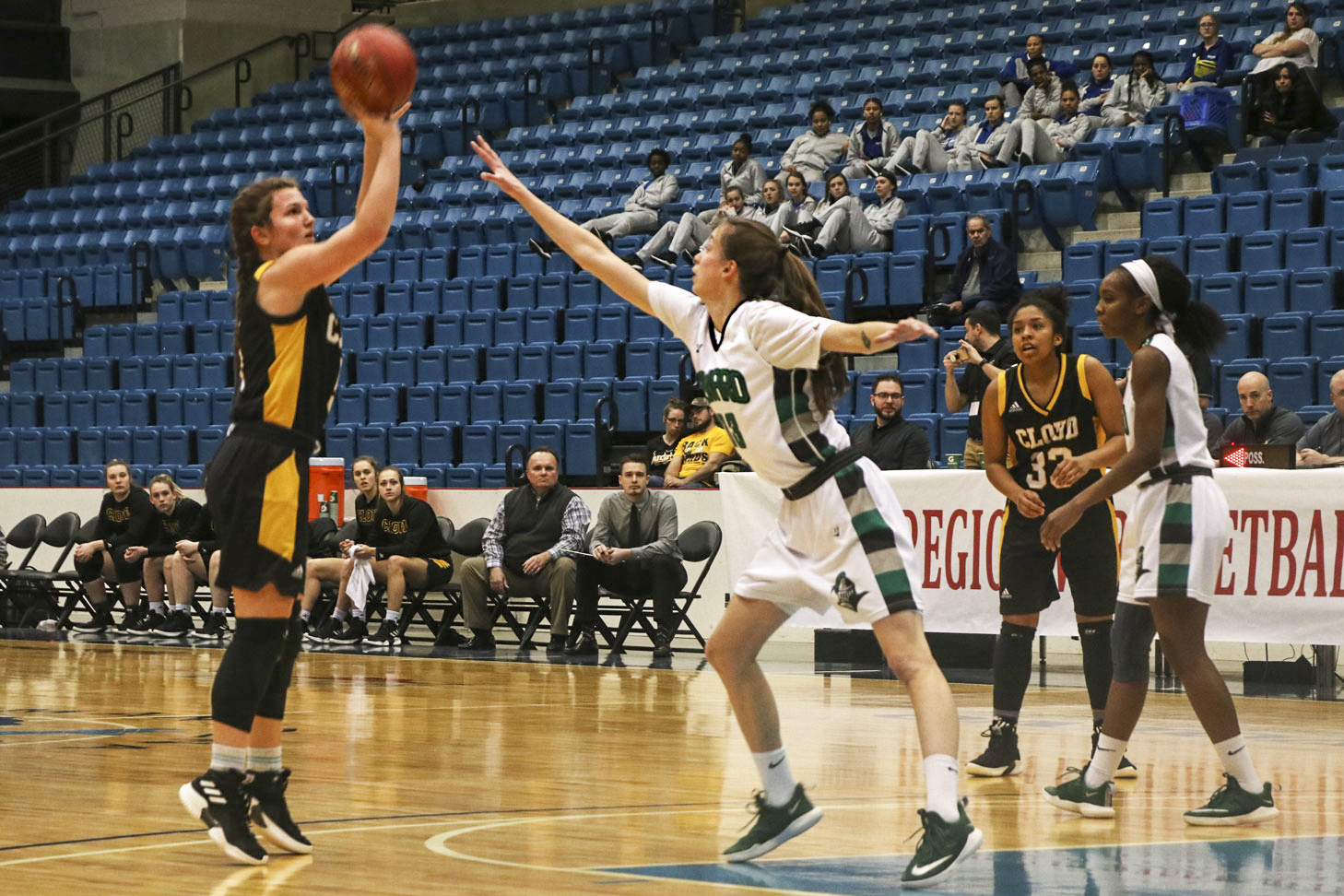 Karolina Szydlowska, forward from Wroclaw, Poland, attempts to block a shot ,trying to keep the Lady Saints ahead. Seward won the game easily 74-59 over Cloud County and advanced to the quarterfinal game at 3 p.m. Monday.