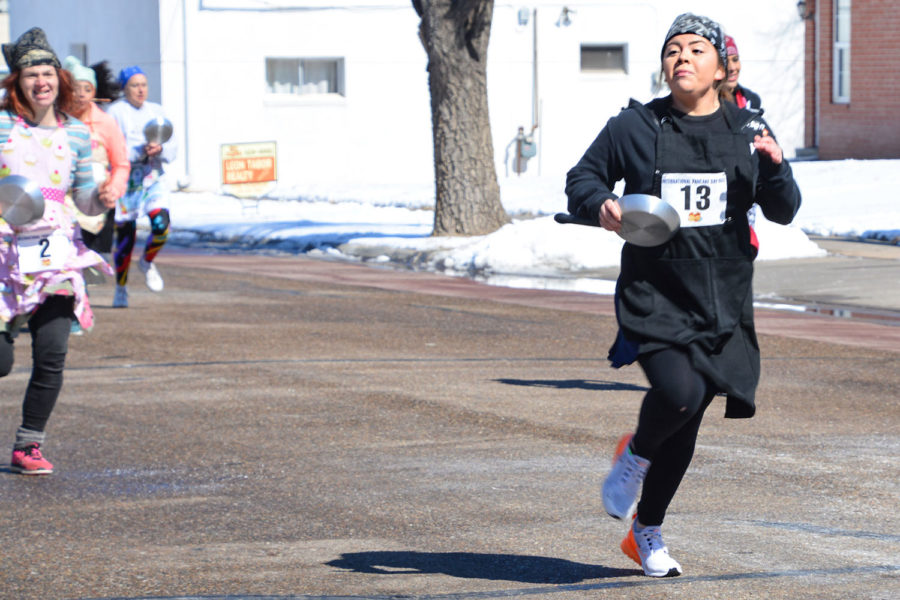 Abby+Lovato%2C+a+SCCC+student+and+Liberal+resident%2C+participated+in+the+Last+Chance+Race.+This+is+the+traditional+race+depicting+a+woman+running+from+her+house+to+church+after+she+realized+she+was+late.+Liberal+competes+every+year+with+their+sister+city%2C+Olney%2C+England.+The+town+with+the+fastest+time+is+named+champion+for+the+year.+Lovato+placed++sixth.