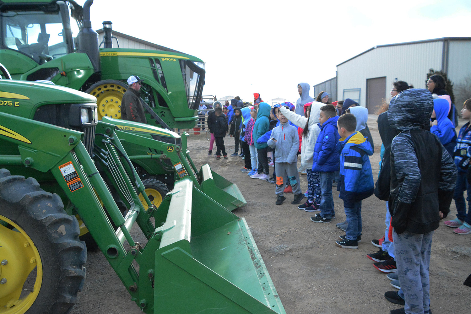 Students gather around tractors and discuss their roles in agriculture. This was part of farm day on Mar. 19.