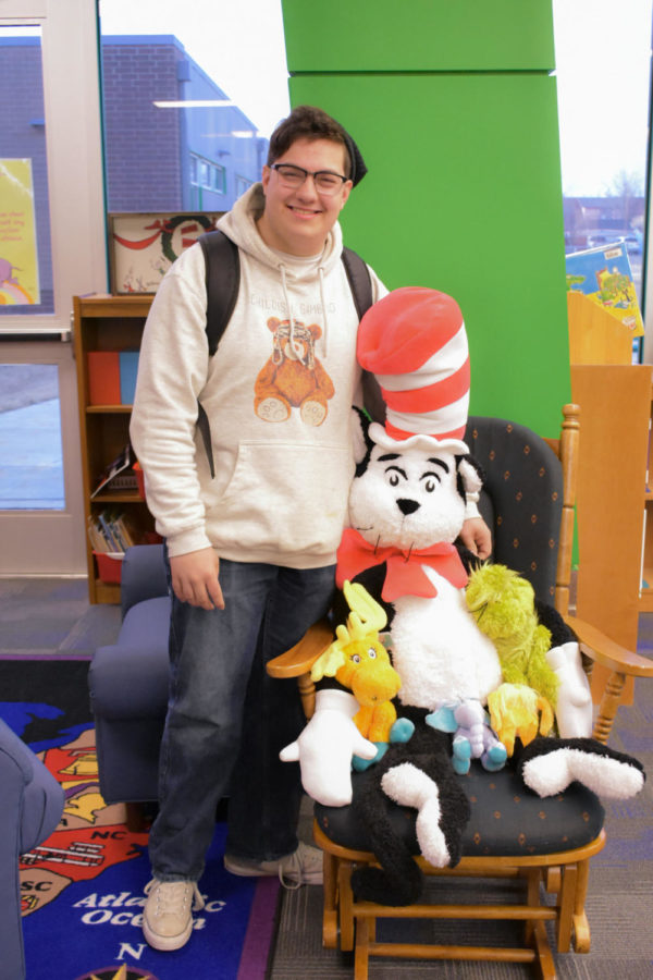 Calen Moore, reporter, makes friends with the Cat in the Hat. Crusader staff read Dr. Seuss books at a Liberal elementary during Dr. Seuss week.