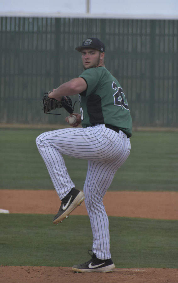 Cole Evans pitches from his windup. The sophomore from Liberal started the game, April 12, against Garden City Community College and came away with the loss.