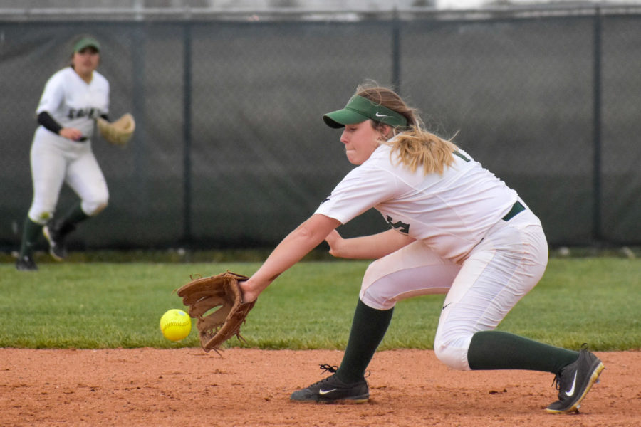 Sophomore+Jordan+Cordrey+backhands+a+bouncing+ground+ball+in+the+infield.+The+Lady+Saints%27+top+pitcher+often+pulls+double+duty+during+doubleheaders+like+this+one+against+Otero+Community+College+and+plays+as+an+infielder+when+she%27s+not+pitching.