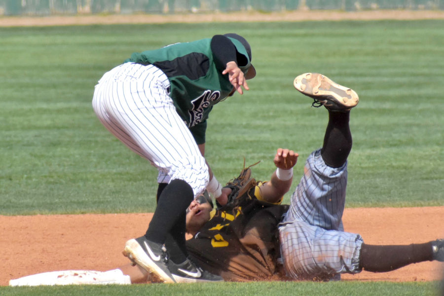 Jose Caraballo, sophomore shortstop, throws a high tag on a Garden City Community College runner trying to steal second.
