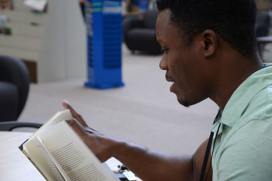 """Patrick Blanc is from Haiti. He graduated from SCCC last year but uses the campus library to take classes with Fort Hays. Whenever, there is some free time Blanc enjoys reading reality books. Blanc said, """"I don't like fantasies books because they are fake."""""""