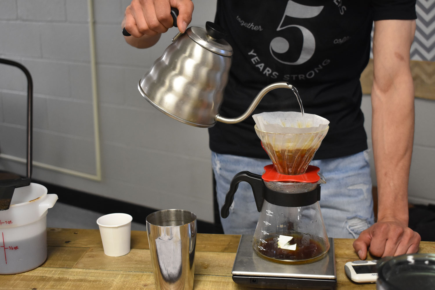 One of the many ways to brew coffee is the pour over method. It starts by wetting the filter then pouring the coffee. Then the coffee must be stirred about five times then the more water is added and must be stirred again. The coffee can be seen dripping down.