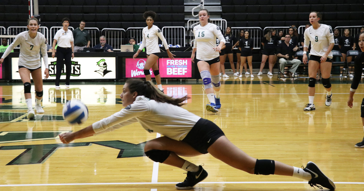 Sophomore outside hitter, Tapanga Johnson, dives for a hard spike and gets the ball up to Laura de Pra.