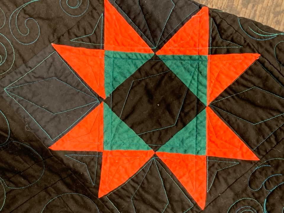 The scholarship auction features donated items like this quilt. All proceeds from the auction go toward student scholarships at Seward County Community College.