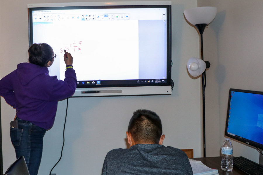 When the internet goes out, everyone has to get creative to teach and get their jobs done. Students in the TRIO office were still able to do math via a wire connection to the smart screen.