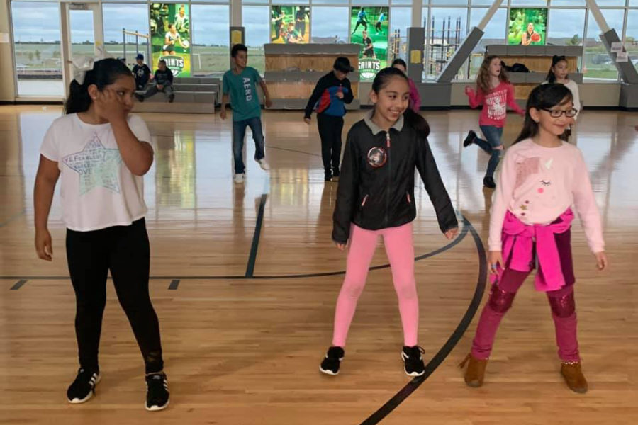 Prairie View Elementary School students dance at the Redesign Parent Night last spring when the school announced that all classes would soon be part of the dual language program.