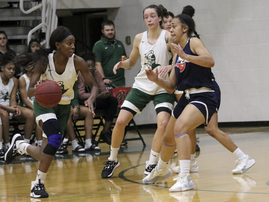 Aquila+Mucubaquire+swings+the+ball+from+the+other+side+to+set+up+the+play+during+a+recent+scrimmage+against+Panhandle+State+University.+She+is+a+sophomore+and+plays+guard+for+Saints.+Saints+basketball+will+take+centerstage+on+Tuesday+as+part+of+the+annual+Basketball+Preview+Night.+Doors+open+at+5%3A30+p.m.+and+admission+is+free.