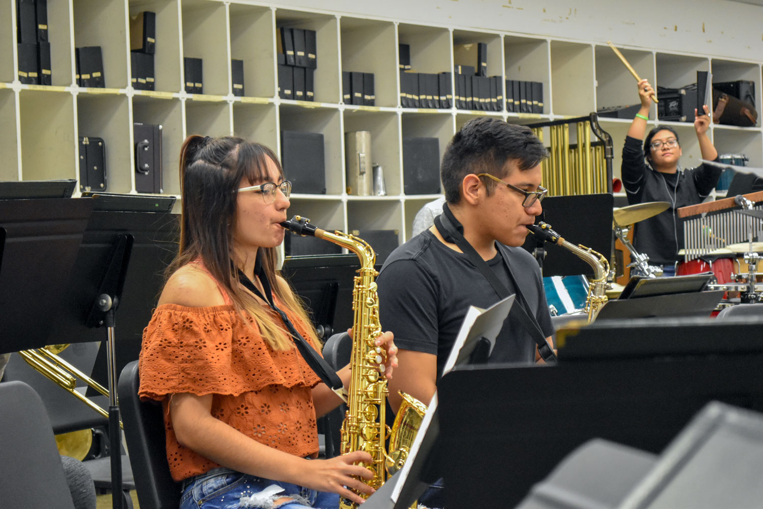 Music majors, Ruby Molina and Miguel Armendariz, play their alto saxophones, while sophomore Maggie Ibarra adds cowbell to a latin tune.