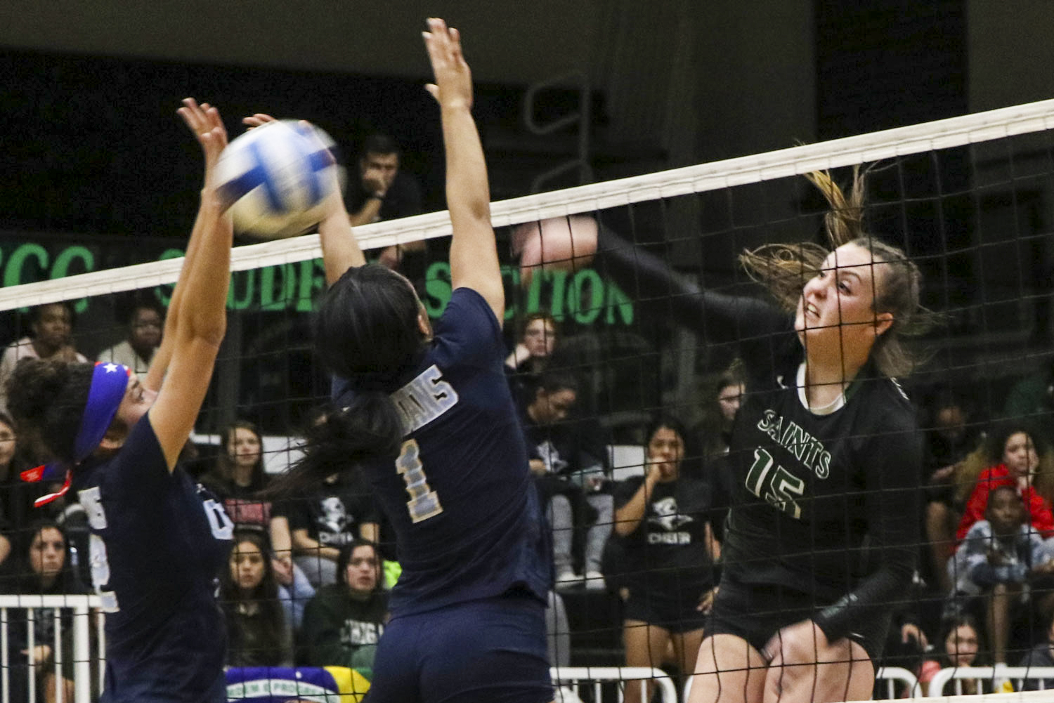 Thais Vieira slams the ball down for two points, helping the Lady Saints win the Region VI Championship. The sophomore middle blocker from Brazil is on her second Regional championship team.