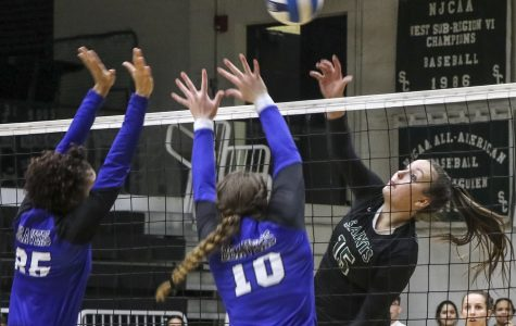 Thais Vieira hits into two Pratt defenders. The sophomore middle blocker had four kills on the night. The Lady Saints easily won the match in three straight sets.