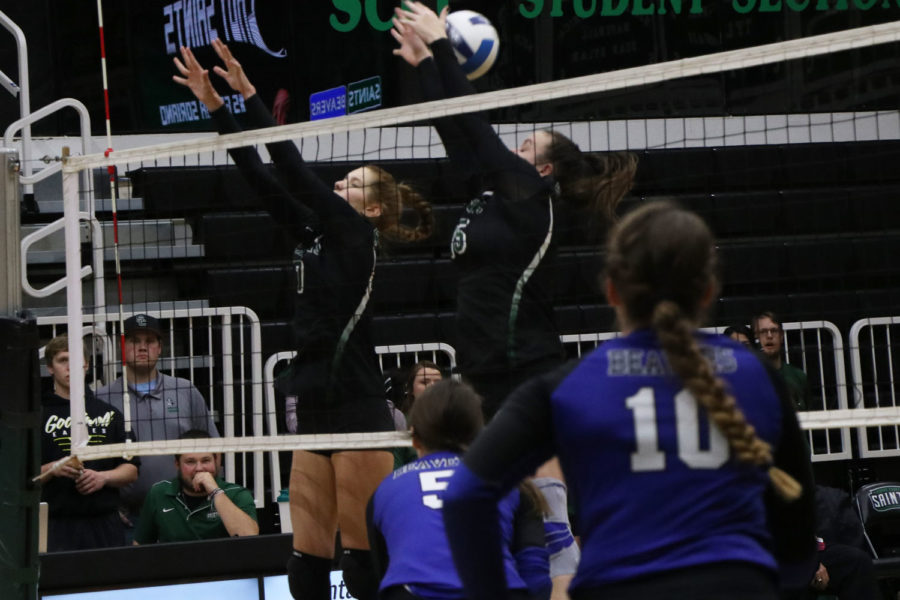 Sophomores+Laura+De+Pra+and+Thasi+Viera+struggle+to+let+the+ball+through+while+the+Lady+Beavers+hit+right+through+their+hands.+Later+in+the+game%2C+they+go+in+denial+mode%2C+not+letting+the+Lady+Beavers+win+set+1.+%0A