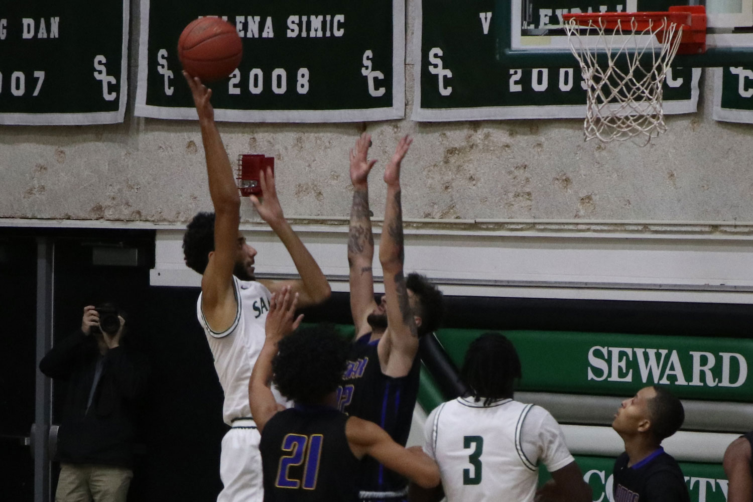 The Seward Saints are 5-1 in game play. Freshman Ahmed Ibrahim drives in for a layup, getting blocked and put on the line to shoot two.