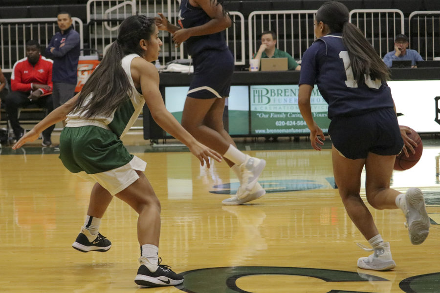 Player no. 4 Kamry Perez defends the basket. She is a freshman point guard from Amarillo, Texas.