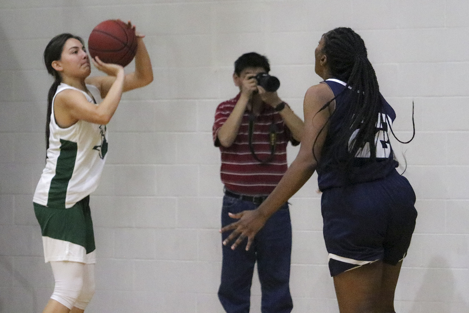 Gina Ballesteros shoots from the corner during a Lady Saints scrimmage. The freshman guard from Ulyssess is one of the few local Kansas athletes playing at SCCC.