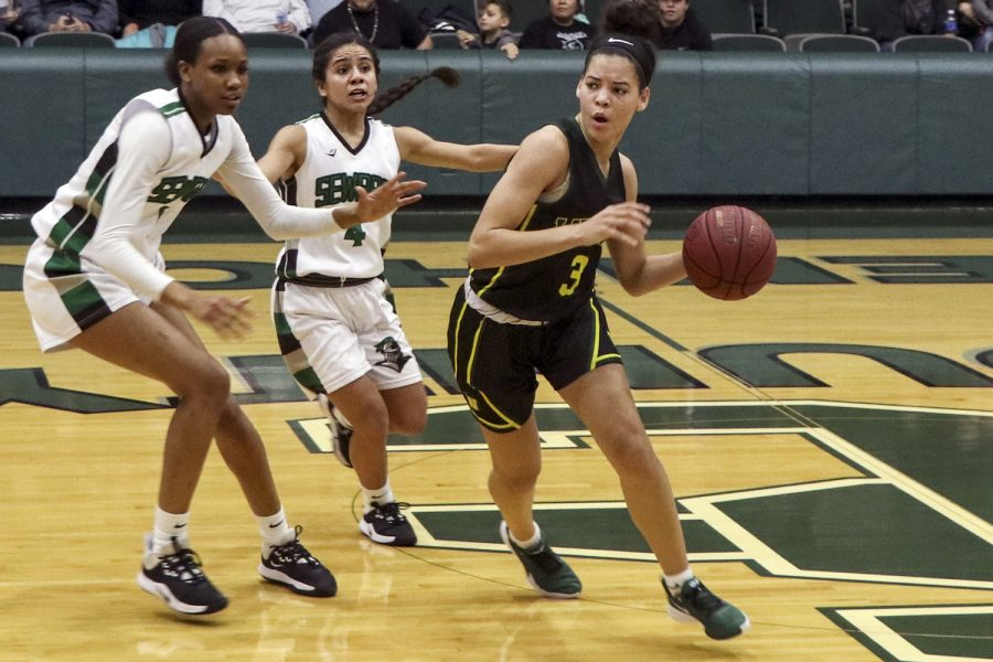 The+Lady+Saints%2C+Ayanna+Smith%2C+1%2C+and+Kamry+Perez%2C+4%2C+set+a+trap.+The+defense+for+Seward+has+been+a+staple+as+of+late.+The+women+held+Garden+City+to+just+five+points+in+the+first+quarter.+%28file+photo%29