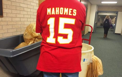 Custodian Chris Schroeder shows off her Patrick Mahones Kansas City Chiefs jersey before the 2020 Super Bowl on Feb. 2. The Kansas City Chiefs and the San Francisco 49ers will be competing.