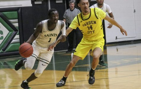 Branton McCrary dribbles past Garden City Community College's Steven Samuels. The freshman guard from Little Rock, Arkansas broke Garden City's press wide open with the dribble move. The Saints won the game 78-73.