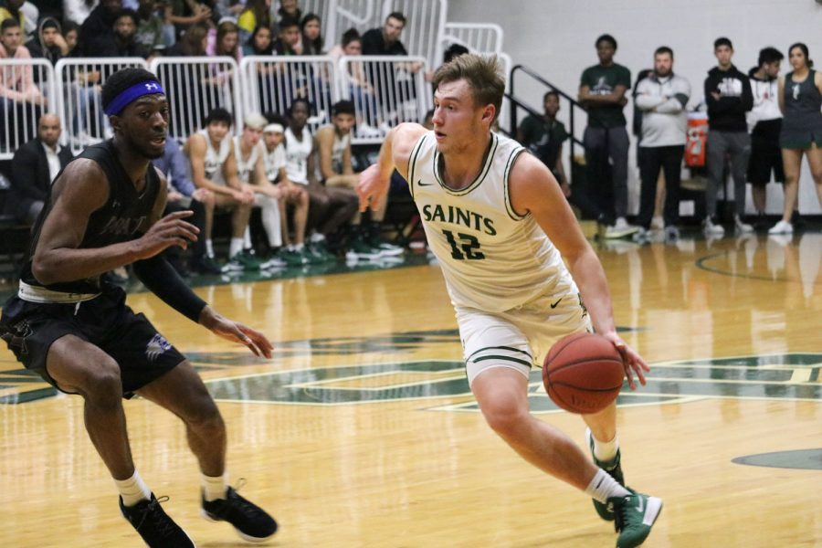 Kyle Cardaci drives to the basket. The sophomore guard is from Holmdel, New Jersey and helped lead the Saints to a 68-63 victory over Pratt Community College. The win was the third in a row for Seward and takes them to 4-5 in Jayhawk West Conference play.