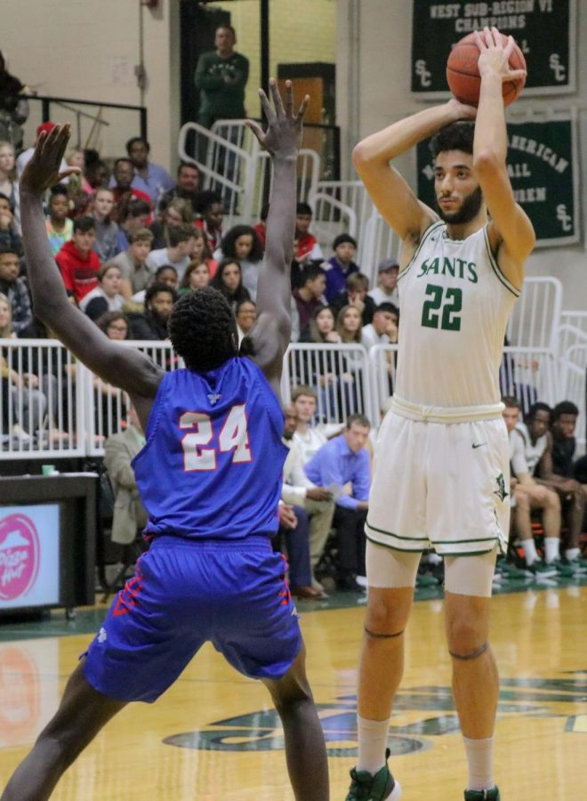 Ahmed Ibrhim stands tall over Hutchinson Community College player. Ibrhim takes him on without breaking a sweat.