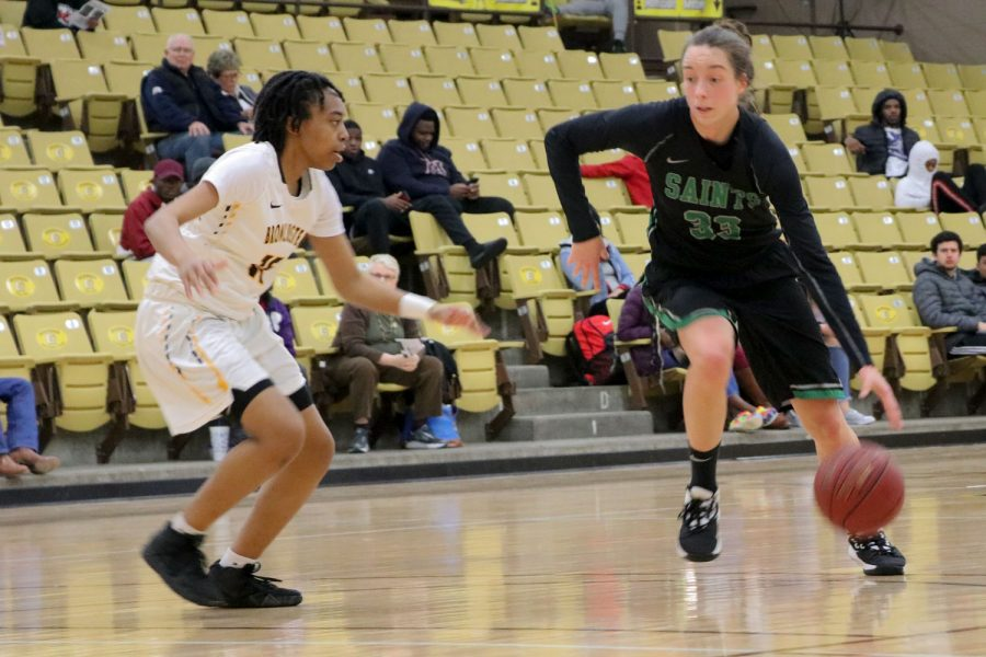 Karolina Szydlowska runs to the basket. She made 18 points last night against Garden City Community College. She plays forward for the Lady Saints and comes from Wroclaw, Poland.