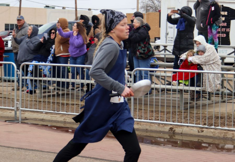 Whitney Hay placed first in the Liberal leg of the Pancake Day race, but lost to Olney, England by three seconds.