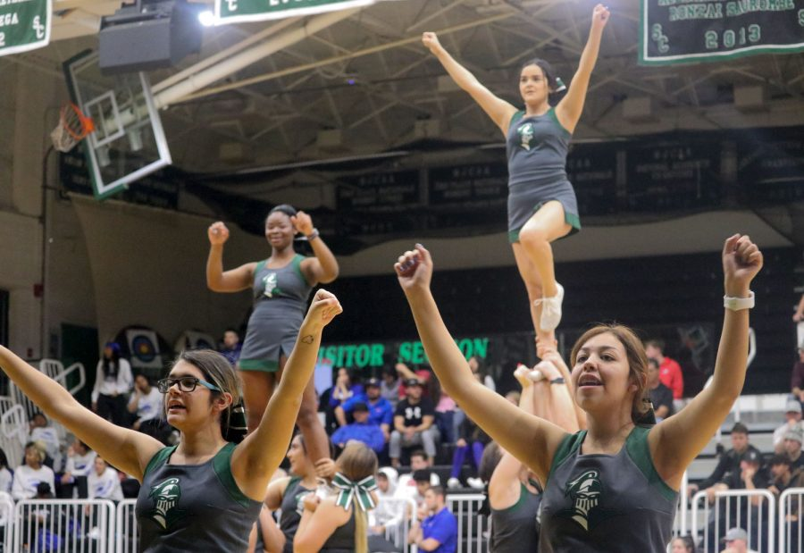 The cheer squad usually performs during a time out and half times. Their routines involve dances and stunts. Sophomore Emily Borjas is seen doing a liberty stunt in the background.