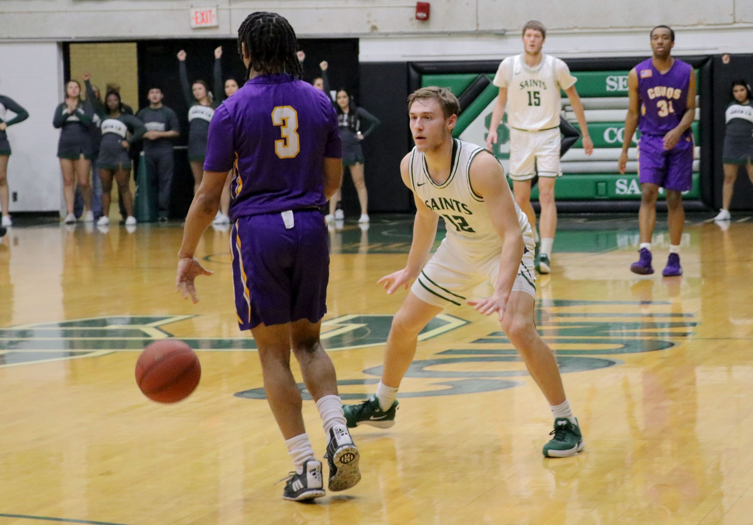 The Saints held a win last night against Dodge City Community College. Kyle Cardaci in defense against Kevin McGaskey.