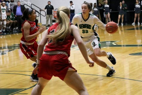 Karolina Szydlowska drives to the basket against Allen Community College. Szydlowska is a sophomore from Wroclaw, Poland. She scored nine points last night. The Lady Saints jumped out to an early lead in the first round of regional play.
