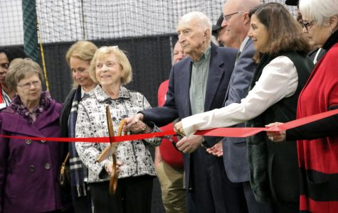 Ribbon cutting makes it the official opening of the Sharp Family Champions Center. Jo Ann and Gene Sharp are the lead donors, who also cut the ribbon.