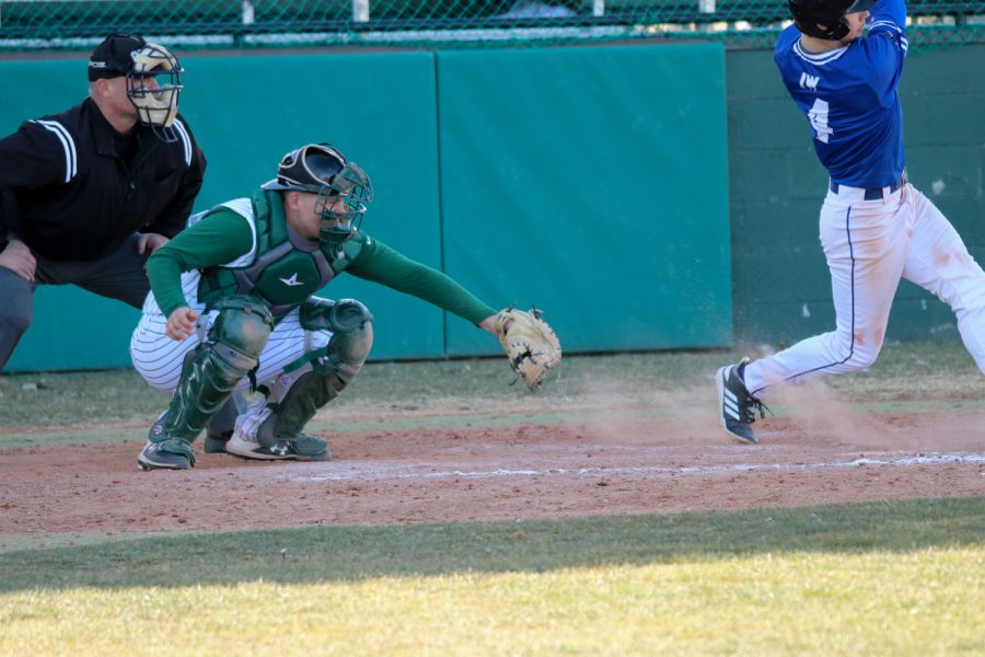 Wyatt Grant catching the pitch. The Saints played Iowa Western Community College in a double head hurt losing 6-1/14-3.