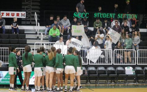 "Ulysses High School came to support the Lady Saints in the Greenhouse. They made posters to show support for the women's team and their hometown player, Gina Ballesteros. One aspect of the ""Greenhouse magic"" is the fan base comes from area towns as well as Liberal."
