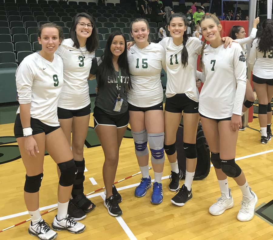 The+Lady+Saints+volleyball+team+is+made+up+of+many+International+students+from+Brazil.+Victoria+Martins+%28center%29+is+also+from+Brazil+and+she+enjoys+going+to+the+girls+game+and+showing+them+some+support.+Pictured+with+Martins+are+Djuly+Schmorantz%2C+Fabiana+Petkowicz%2C+Thais+Vieira%2C+Laura+de+Pra%2C+and+Livia+de+Pra.