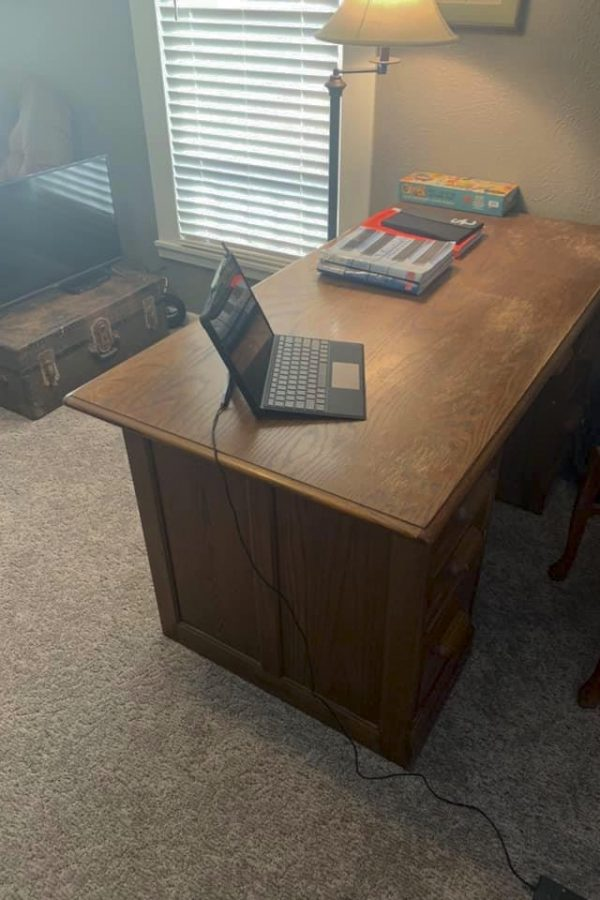 Darin Workman, instrumental music instructor, has set up his office at home. Most teachers and students have adjusted to their new normal by figuring out a place where they will need to work from home.