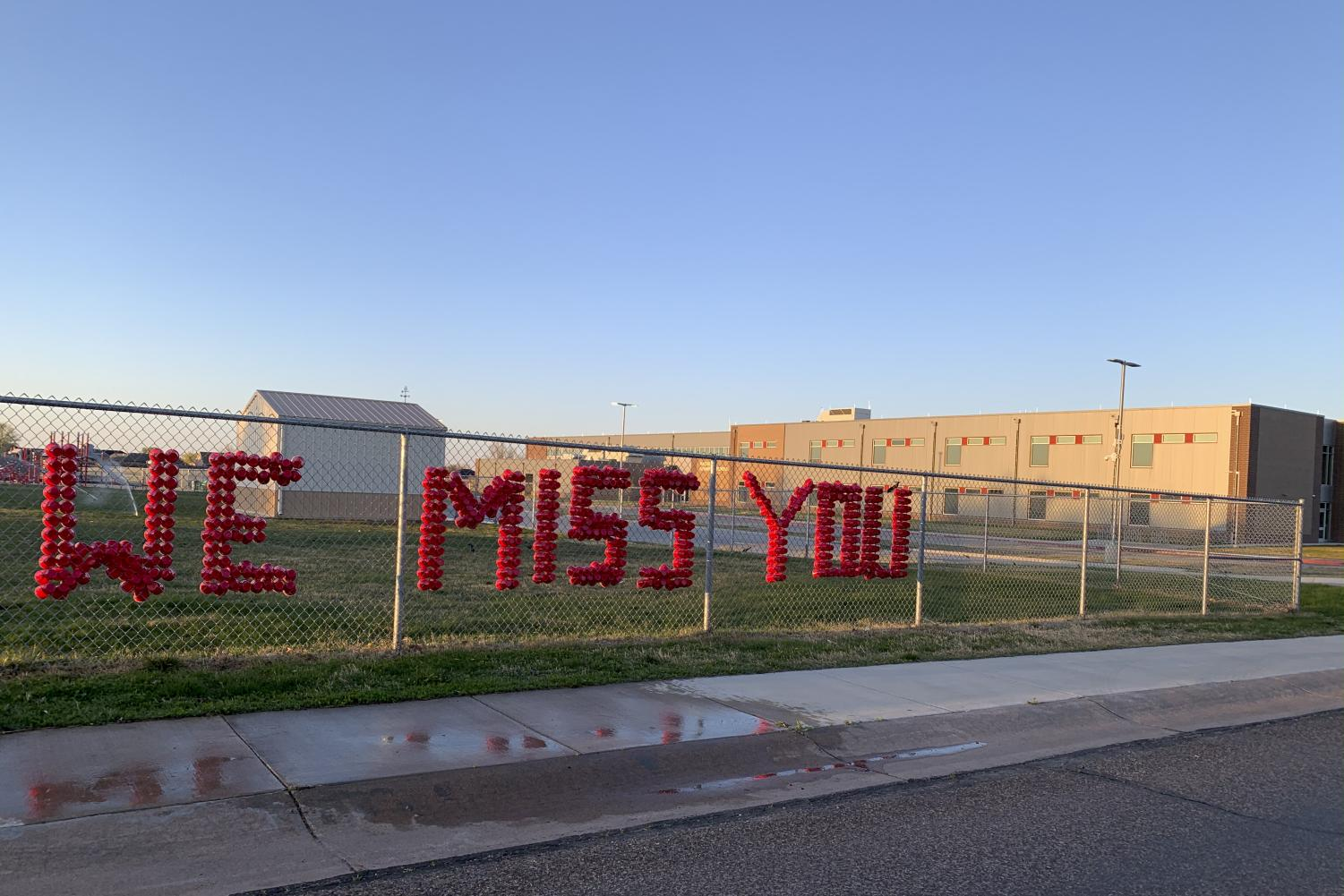 McArthur+Elementary+school+placed+these+cups+to+spell+%E2%80%9CWe+miss+you%E2%80%9D+on+the+fence+to+show+their+students+that+they+are+still+thinking+of+them+through+tough+times.+