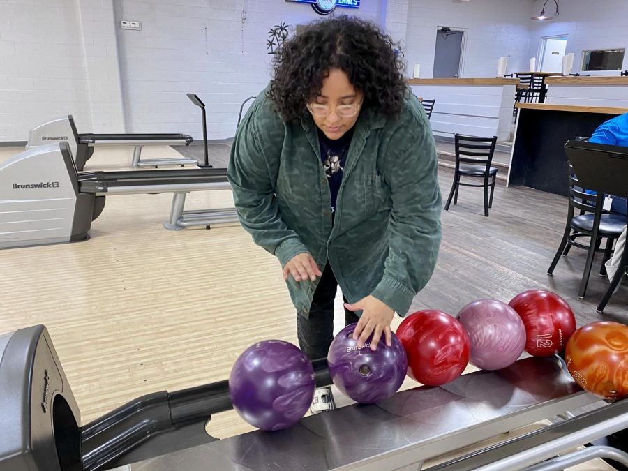 Raven Staten picks out a bowling ball at the Crusader final's party. Staff didn't bowl all the games like normal ... they made up rules as they went, often bowling with their opposite hand or while dancing down the lane.