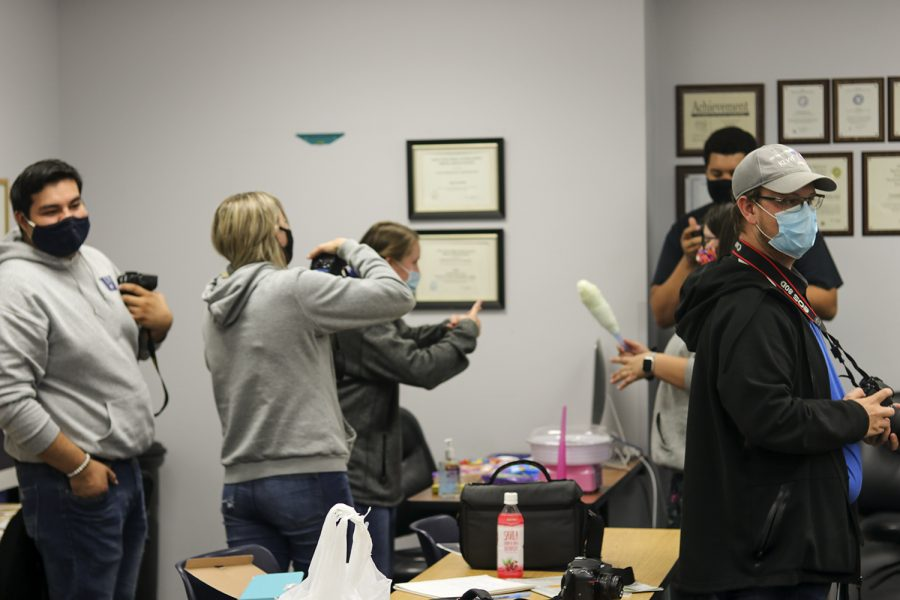 Crusader Staffers photograph the process of making cotton candy. Closely after this photo was taken, the rest of the staff had the opportunity to try their favorite flavor.
