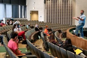 The Human Anatomy Class receives instructions about class from Donald Hays, instructor. Students are spread out all over the theater in an effort to practice social distancing. In past semesters, this class met in a lecture hall in the Hobble Building. Prior to this semester, the only classes in the theater had been music and theater before concerts or plays.