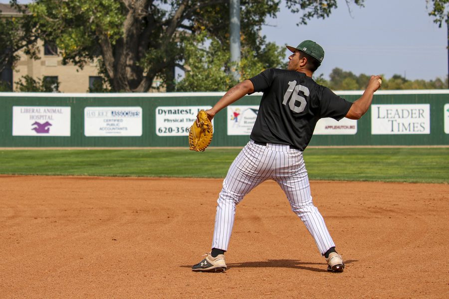 Javier Bojorquez, a third base man prepares to throw the baseball back to his teammates during a practice match