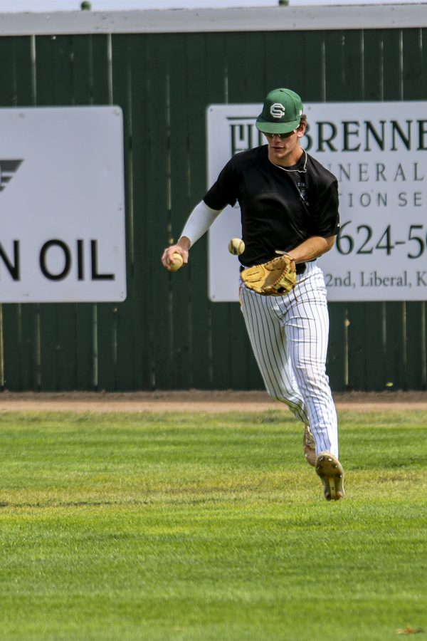 Josh Eichstadt, a infielder runs back to his postions to pitch back a ball to his teammates