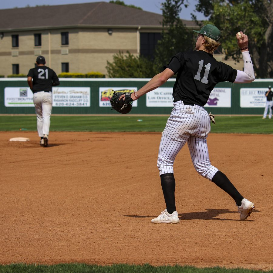 Peter Goldy, a pitcher gets ready to pitch back the ball after catching