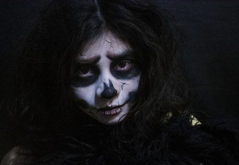 """Halloween is a time when everyone gets into the """"spooking"""" spirit. Photography 1 students tried to take the spookiest picture, like this one of a zombie. Public Speaking students told their favorite ghost stories. Saints Bookstore hosted a costume contest. Whether it"""
