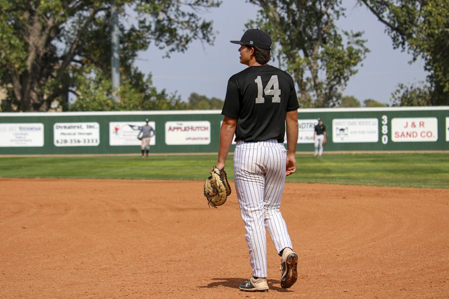 Wyatt Grant, a catcher waits patiently for a ball to fly in his direction
