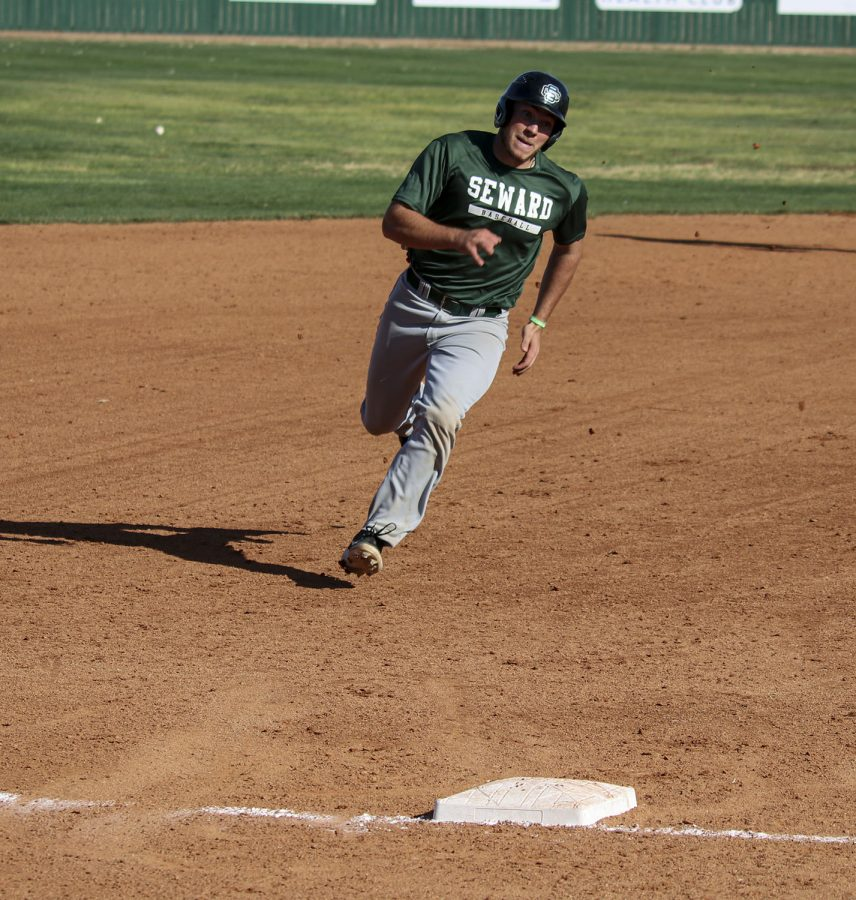 Aj Folds rounds third base and heads for home to score in the Aug. 5 scrimmage against Dodge City Community College.