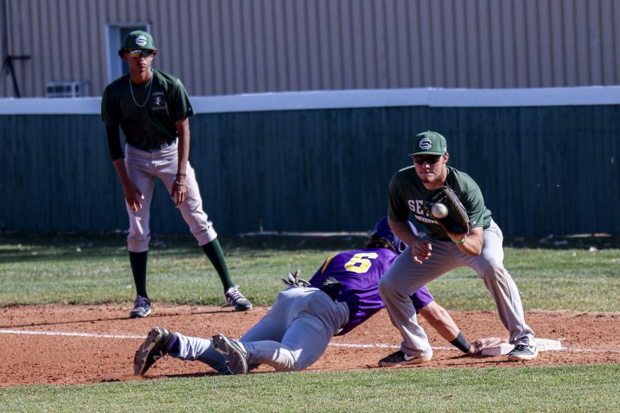 Braden Boisvert, a freshman from Sonoita, Arizona, grabs a pick-off play on first base. Dodge City managed to slide in without being tagged.