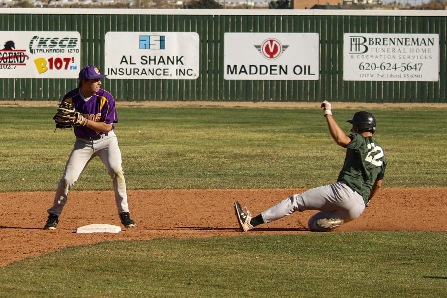 KP Werner, a sophomore from Greeley, Colorado, slides into second base. This is the second time Seward and Dodge City have scrimmaged.